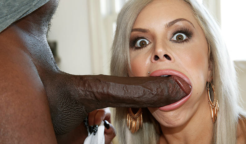 Nina Elle takes huge black cock into mouth
